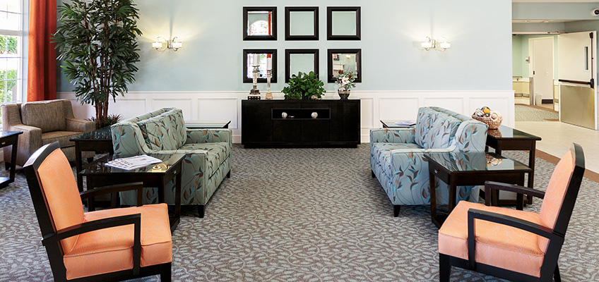 lobby area with seating and patterned carpeting