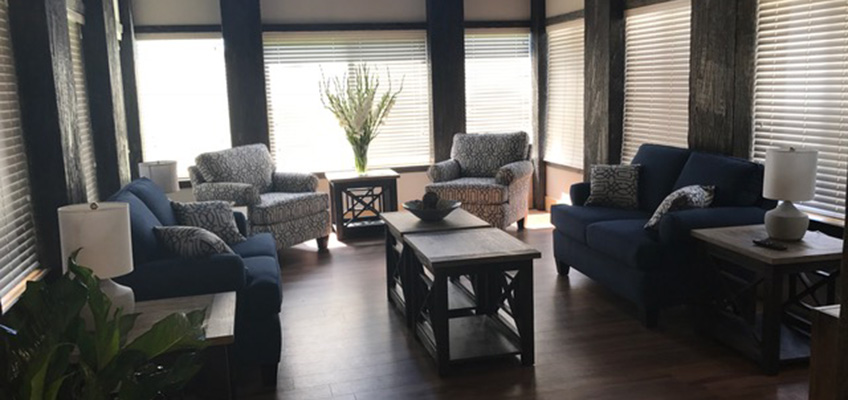 The Gables at Manokin living center with comfortable seating and many windows