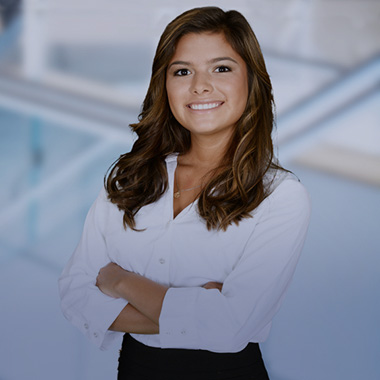 Business professional standing with her arms folded