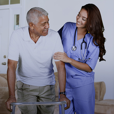 Nurse assisting resident with walking using his walker