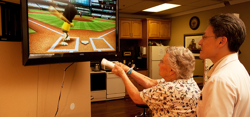 A resident working on rehabilitation playing sport Wii