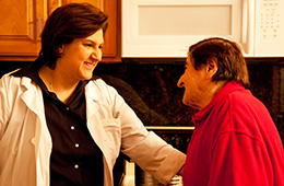 A staff member speaking to a resident