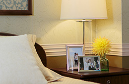 A resident room with images of loved ones on the side table