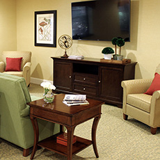 recreation room with flat screen TV and comfortable upholstered chairs