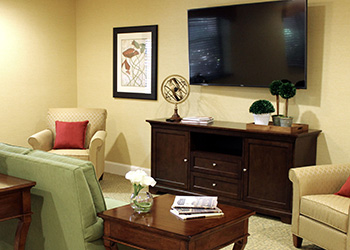 recreation room with flat screen television and comfortable seating