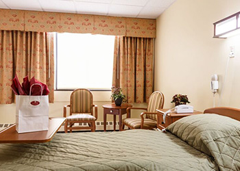 single occupancy room with welcome gift