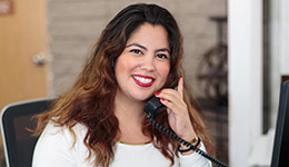 smiling receptionist answering the phone