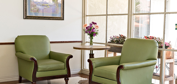 sunny corner nook with chairs and flowers