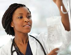nurse administering an IV