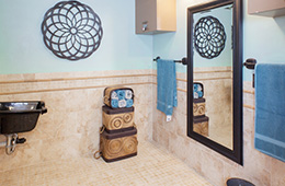 bathroom area with wall art and storage bins