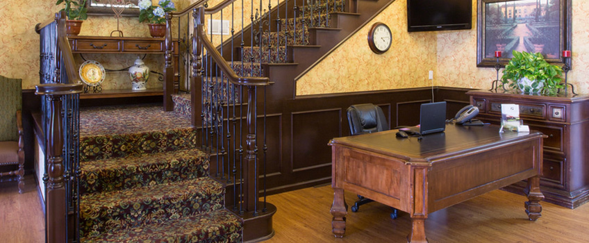 fine wooden desk and carpeted staircase