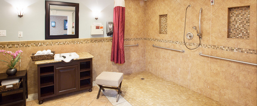 large shower area with nicely tiled floor and walls