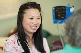 asian nurse smiling brightly