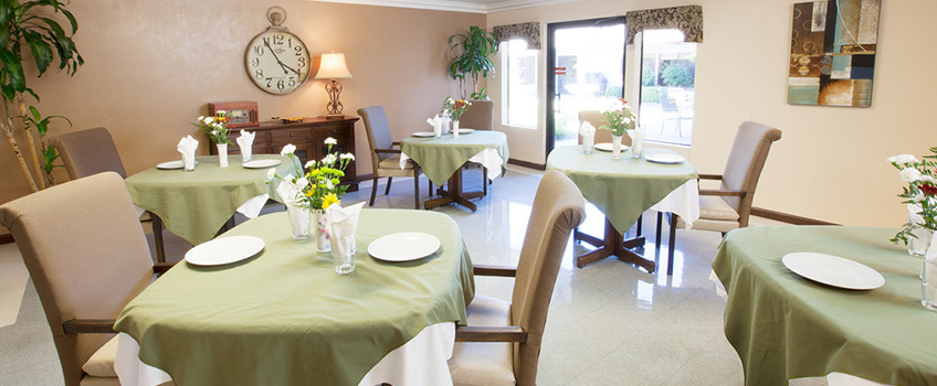 dining area with soft looking chairs and tableclothes
