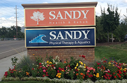 sandy health and rehab signage