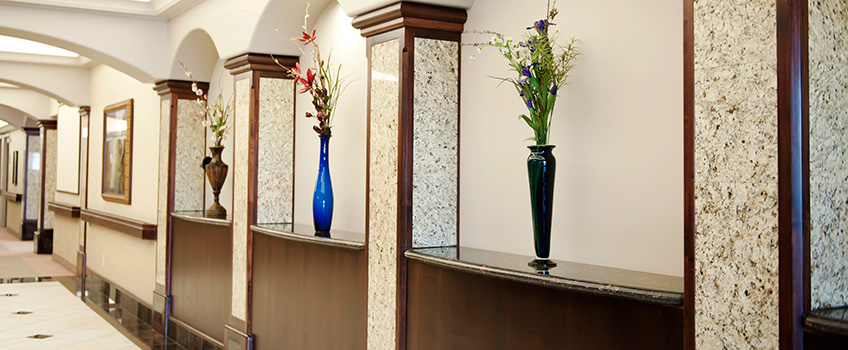 assorted ornamental vases lining a hallway