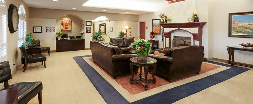 lobby with fireplace and leather couches
