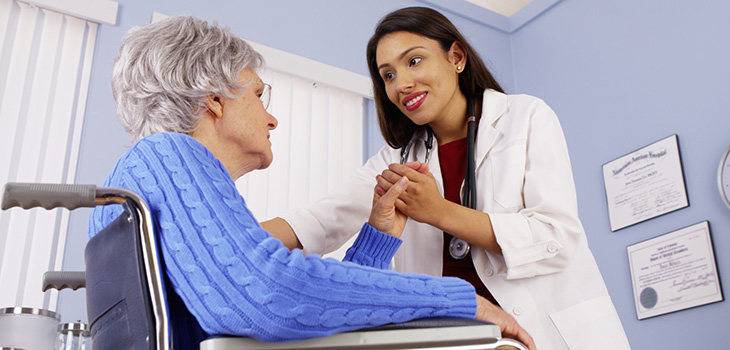Doctor holding the hand of one of her patients