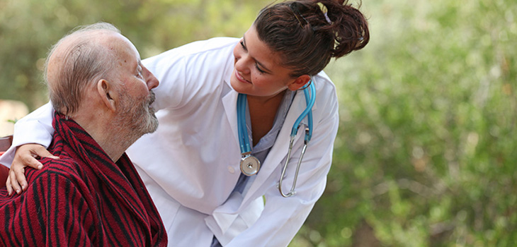A nurse outside with a resident