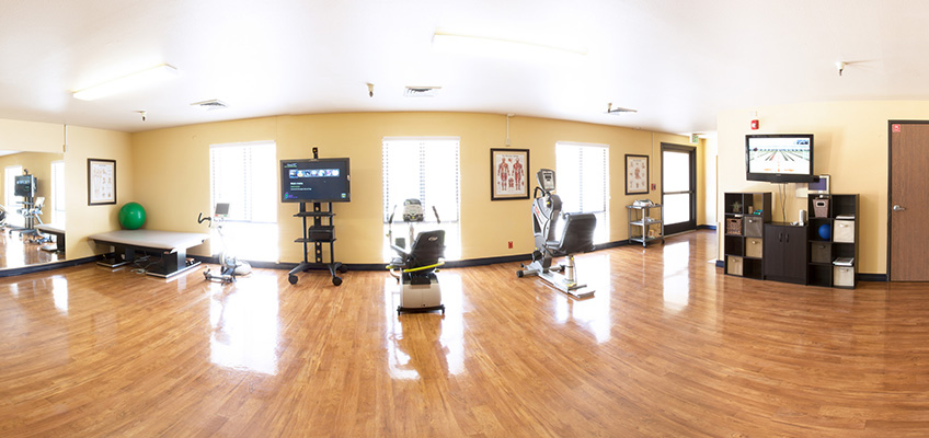 beautiful rehabilitation room with shiny wood flooring