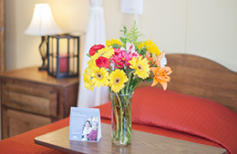 flowers on a bedside table