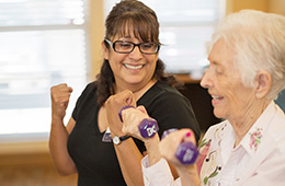 female resident lifting hand weights