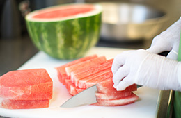 chef slicing watermelon