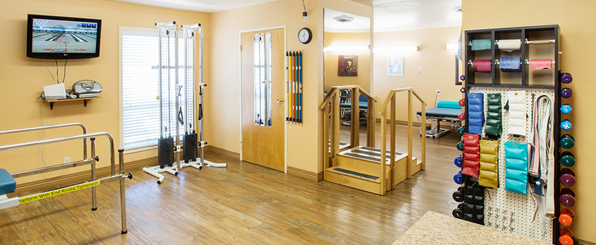 rehabilitation room with weights and pulleys