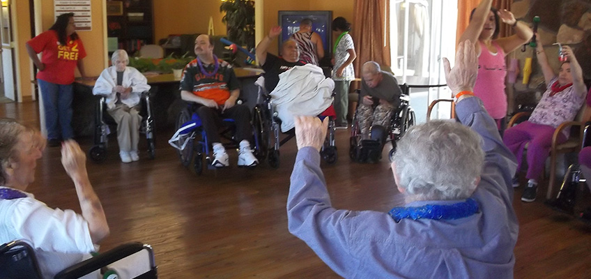 multiple residents participating in a wheelchair exercise class