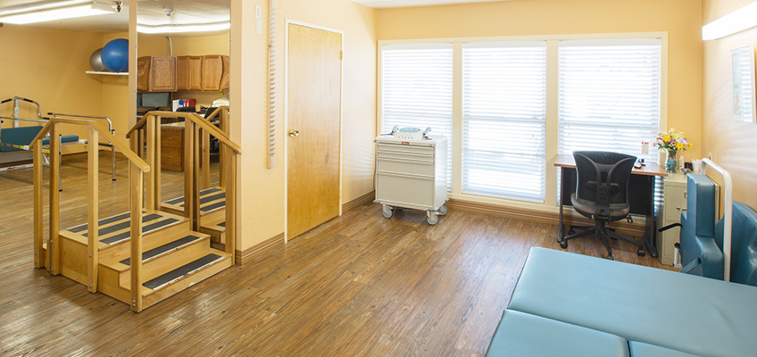 rehabilitation room with stairs and equipment