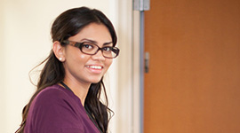 smiling nurse wearing glasses