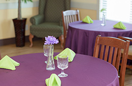 table setting in dining room with tablecloths
