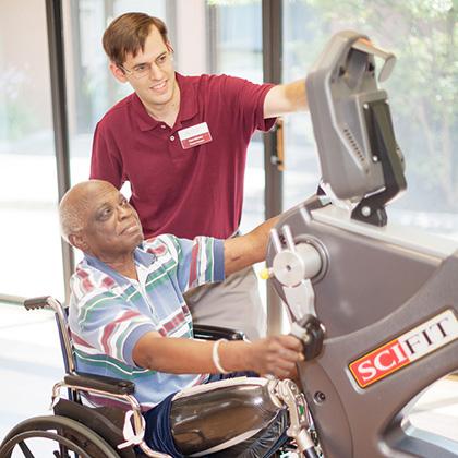 resident in wheelchair using hand bike