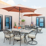 outdoor tables, chairs, and umbrellas on patio