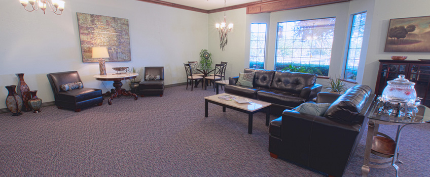 large couches with a large window in a lobby style area