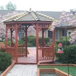 Beautiful gazebo outside with walking path and flowered trees