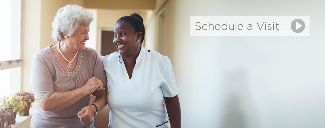 nurse walking with patient