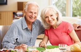 smiling couple eating dinner