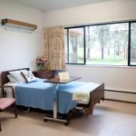 single occupancy room with a view to the trees and grass outside