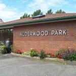 Alderwood Park sign on brick wall of building