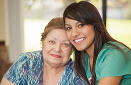 resident and nurse smiling