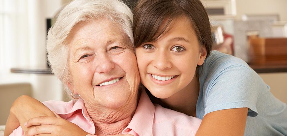 young woman hugging her grandma