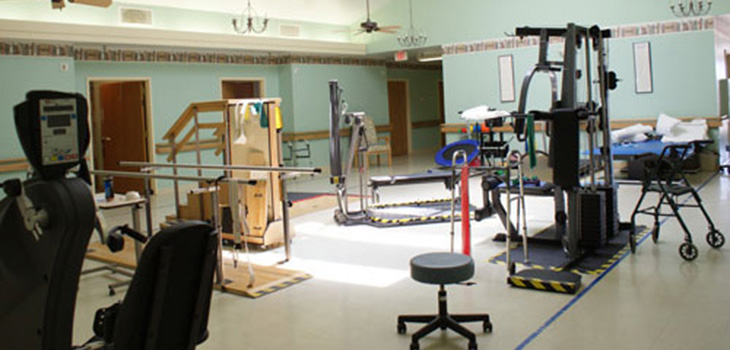 clean rehabilitation room with lots of equipment