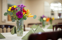 resident dining table with flowers in a vase