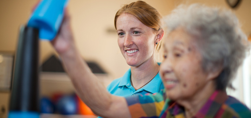 nurse working with rehab resident