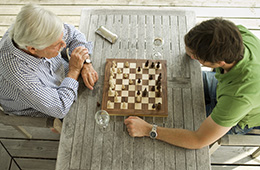 Two men sitting together playing chess