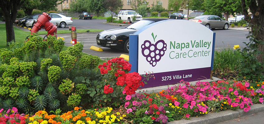 Napa Valley sign outside surrounded by flowers