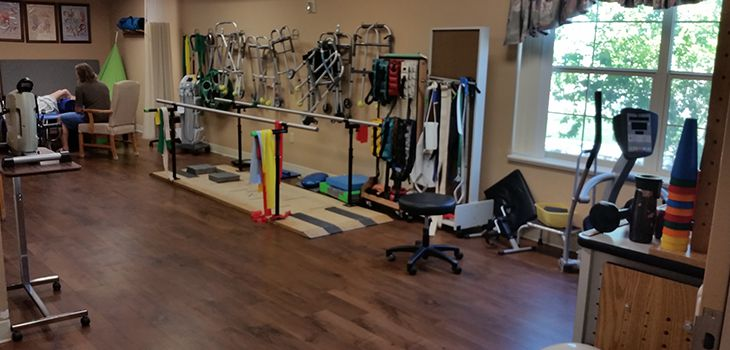 rehab room with lots of equipment