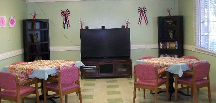 dining room with a large television