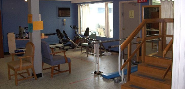 rehabilitation room with lots of equipment